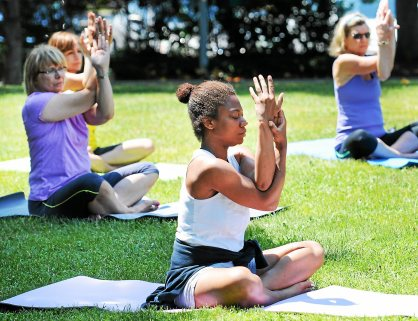 An outdoor yoga class was held on the lawn at Smith Family Plaza Thursday as part of the Fit For Life program. Photo by John Strickler The Mercury