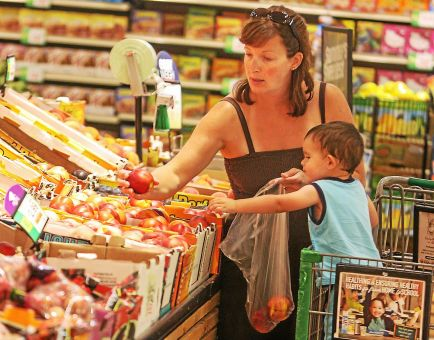 Photo by Kevin Hoffman/The Mercury File - A shopper and her son search for healthy food items at the Giant store.