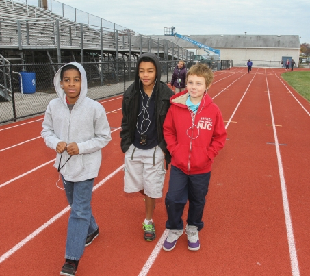 KEVIN HOFFMAN - THE MERCURY Pottstown Middle School students walk around the high school track to stay fit and healthy.