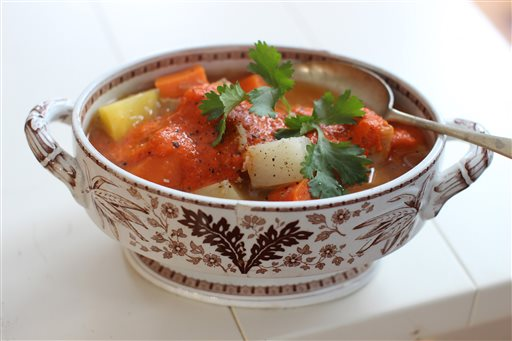 This Dec. 8, 2014 photo shows Moroccan chicken in a pot with harissa in Concord, N.H. (AP Photo/Matthew Mead)