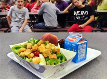 A healthy chicken salad school lunch, prepared under federal guidelines, sits on display at the cafeteria at Draper Middle School in Rotterdam, N.Y. AP Photo