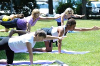FILE: Women participate in an outdoor yoga class at the Smith Family Plaza in Pottstown. Regular exercise is one way that women can reduce their risk for heart disease. John Strickler — The Mercury