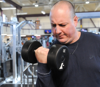 Jason Leh does weight training along with his cardio workouts at the Pottstown YMCA wellness center. Digital First Media File Photo
