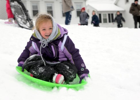 FILE: Bailee Cramer, from Schuylkill Haven, Pa., rides her sleigh down the hill at the Schuylkill Haven High School on Saturday, Jan. 21, 2012. A weekend storm blanketed Pennsylvania in the first significant snow of the season Saturday. (AP Photo/The Republican-Herald, David McKeown)