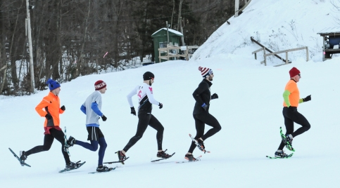 John Strickler - The Mercury File - The top five snowshoe racers lead the way across the Spring Mountain Adventures skiing hills.