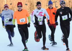 John Strickler - The Mercury Racers run the 5k course set up at Spring Mountain Adverture for the 10th Annual Pa. Snowshoe Race.