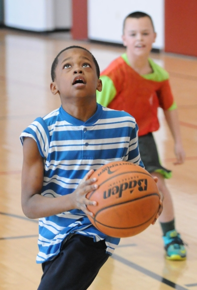 John Strickler - The Mercury Phoenxiville School District play three on three basketball during a tournament at the Phoenixville YMCA to raise awareness against smoking.