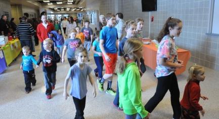 John Strickler - The Mercury Boyertown area children walk laps through the halls of Boyertown High School during the Boyertown Wellness Fair held Saturday.