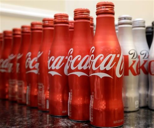 This March 7, 2015 photo shows 8.5 ounce bottles of Coca-Cola at the Cadillac Championship golf tournament in Doral, Fla. (AP Photo/Wilfredo Lee)