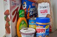Foods that might have added sugar or another sweetener like high-fructose corn syrup as an ingredient are pictured Wednesday, March 4, 2015, in New York. (AP Photo/Bebeto Matthews)