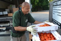 Common Market driver Will Griffin makes a delivery. In 2015, Common Market will work with more than 80 family farms to deliver fresh, healthy foods to schools, hospitals and other customers. Photo courtesy Common Market.