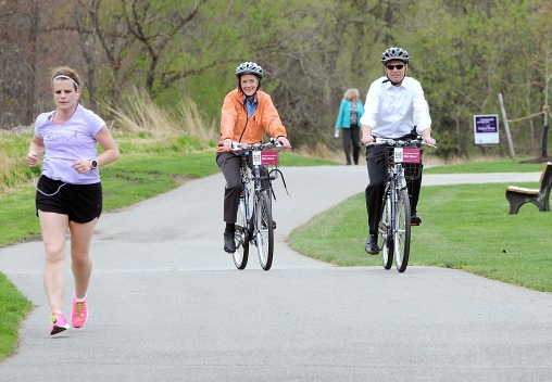 Gene Walsh — For Digital First Media Montgomery County commissioners Val Arkoosh and Josh Shapiro test ride bike during the launch of pilot bike share program at the Lower Perkiomen Park in Oaks April 22, 2015