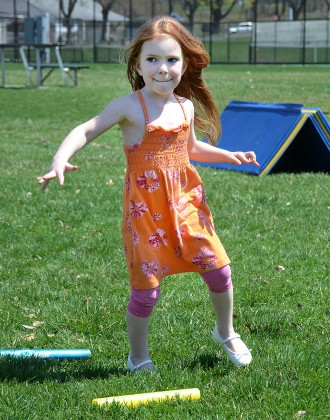 """Six year old Madison Mest negotiates her way through a running event during the """"Pottstown Celebrates Young Children"""" event sponsered by Pottstown PEAK.....Photo/Tom Kelly III"""