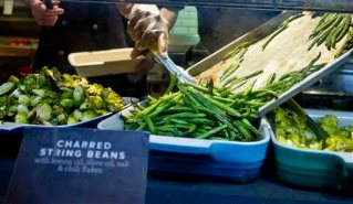 """In this March 12, 2015 photo, oven cooked string beans join other vegetable varieties ready for the lunchtime crowd at The Little Beet at the restaurant in New York. For years, healthy chains have sputtered and flopped but The Little Beet chef Franklin Becker, who's opening seven more restaurants in the New York area this year, says the demand is growing. """"That's what people want to eat. They want honest foods now."""" (AP Photo/Bebeto Matthews)"""