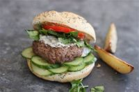 This is a lamb burger with watercress and creamy mint sauce. To keep the lamb burgers extra mild, the recipe adds another variety of ground meat, usually turkey or lean beef. Matthew Mead — The Associated Press