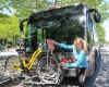 John Strickler - The Mercury Pottstown assistant borough manager Erica Weekley places bicycle on the new bike racks that are installed on the PART buses. Bicycle riders can now ride the busf and have their bikes with them when they arrive at their destination.