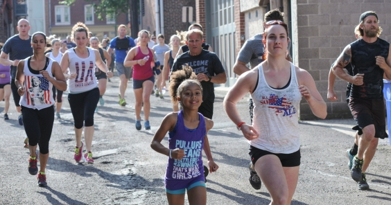 John Strickler - The Mercury Cross Fit of Pottstown held a 'Memorial Murph' workout on Memorial Day to honor the late U.S. Navy Lt. Michael Murphy who died in action. Pictured here members and others joining the event run their first mile.