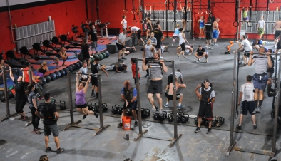 John Strickler - The Mercury Cross Fit of Pottstown held a 'Memorial Murph' workout on Memorial Day to honor the late U.S. Navy Lt. Michael Murphy who died in action. Pictured here participants do pull-ups, push-ups and squats as part of the exercise event. The former armory on King Street is filled with enthusiastic people doing the workout training.