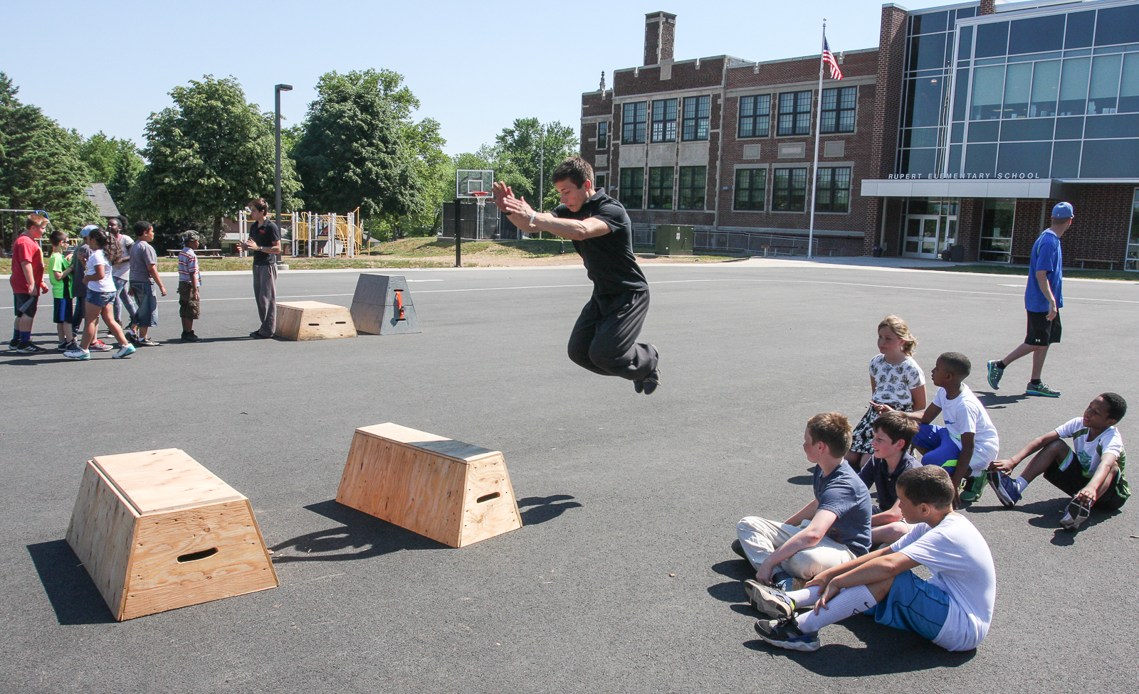 parkour students move through obstacles at rupert elementary