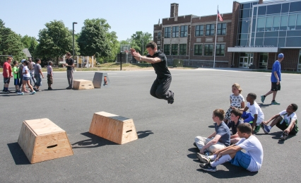 KEVIN HOFFMANÐTHE MERCURY Fitness coach from Lehigh Valley Parkour jumps to standing wooden platforms for fitness program at Rupert Elem.