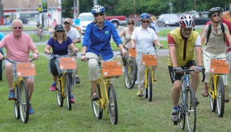 John Strickler - The Mercury Secretary of the D.C.N.R Cindy Adams Dunn, center in the blue top, riding a Bike Pottstown bicycle arrives at Memorial Park Thursday June 25, 2015 to make an announcement on the five year outdoor recreation plan for Pennsylvania.