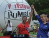 John Strickler - The Mercury A Gold Medal Town - Three time Olympic beach volleyball gold medalist Misty May-Treanor, left and the Secretary of D.C.N.R. Cindy Adams Dunn clasp hands as they acknowledge Pottstown's commitment to recreation on center court of the Pottstown Rumble.