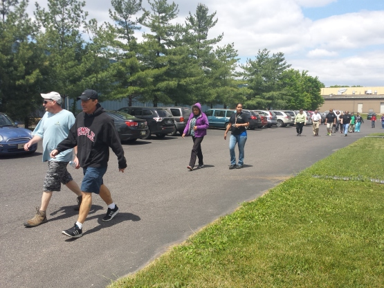 Walkers participate in The Mercury Mile walk, a weekly lunchtime exercise. Michilea Patterson — The Mercury