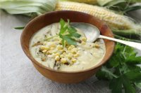 This June 8, 2015 photo shows corn chowder with sunflower seeds and onions in Concord, N.H. This dish was made from a recipe by J.M. Hirsch. (AP Photo/Matthew Mead)