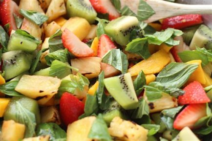 This June 8, 2015 photo shows grilled pineapple fruit salad in Concord, N.H. (AP Photo/Matthew Mead)