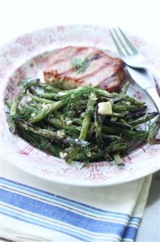 This May 18, 2015 photo shows grilled green beans with honey, feta and dill in Concord, N.H. (AP Photo/Matthew Mead)