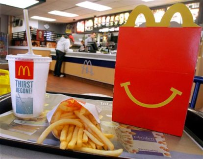 FILE - This Jan. 20, 2012 file photo shows a Happy Meal with french fries and a drink at a McDonald's, in Springfield, Ill. McDonald's on Thursday, June 25, 2015 said fewer people are picking soda for Happy Meals after it stopped listing the drinks as an option on its menu boards. (AP Photo/Seth Perlman, File)