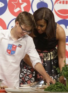 U.S. first lady Michelle Obama participates in a cooking demonstration at the James Beard American Restaurant with Italian and American middle school students in Milan, Italy, Wednesday, June 17, 2015.  Michelle Obama is in Milan on the second leg of a European trip that puts an international spin on her core initiatives. (AP Photo/Antonio Calanni)