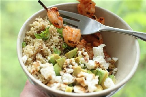 This June 1, 2015 photo shows quinoa shrimp salad with avocado and pomegranate molasses in Concord, N.H. This recipe features ingredients that pack big, bold and filling flavor, without requiring a whole lot of time or labor. (AP Photo/Matthew Mead)