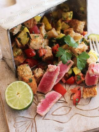 This photo shows grilled tuna panzanella. Matthew Mead — The Associated Press