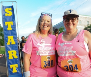 John Strickler — The Mercury. Terri Valinote, left, and Sheri Reazor, right, pose for a photo before starting the first ever Pottstown Half Marathon race on Saturday morning. The half-marathon was their first long-distance race.