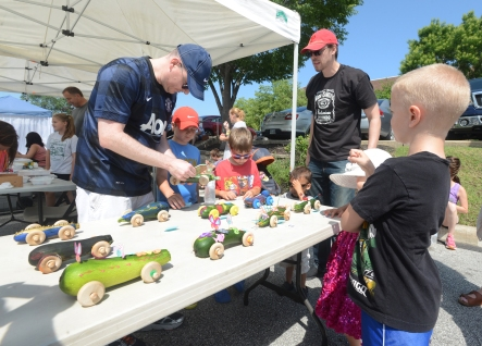 The Contestants ready their vehicles before the Zucchini 500 kicks off at the Upper Merion Farmer's Market. Saturday, July 11, 2015. Adrianna Hoff—The Times Herald.