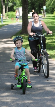 John Strickler - The Mercury Brittney Yanchek took her nephew Keegan Bessemer along the Schuylkill River Trail for a bicycle ride through Riverfront PArk in Pottstown Friday. The Schuylkill River Trail was named the best urban trail in the United States.