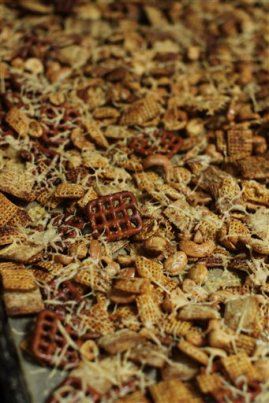 This June 15, 2015 photo shows cheesy toasted snack mix in Concord, N.H. This dish is from a recipe by Alison Ladman. (AP Photo/Matthew Mead)