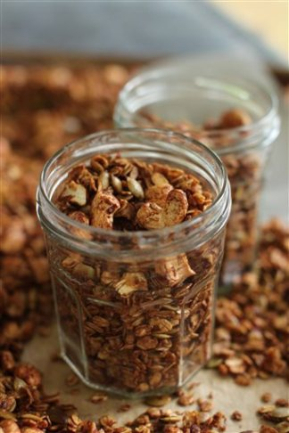 This June 15, 2015 photo shows cinnamon citrus granola with pepitas and cashews in Concord, N.H. This dish is from a recipe by Alison Ladman. (AP Photo/Matthew Mead)