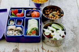 "FILE - This July 9, 2012 photo shows a Japanese bento box and Indian Tiffin that offer a multinational version of the traditional brown bag lunch in Concord N.H. Today's lunch ""systems"" are dominated by bento-style gear, which originated in Japan and involve multiple compartments and containers to hold a variety of foods. And that makes sense for modern kids, who are as likely to be toting sushi and DIY taco kits as they are the classic PB&J. (AP Photo/Matthew Mead, File)"