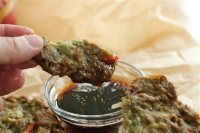 This July 13, 2015 photo shows Korean mung bean pancakes in Concord, N.H. Mung beans have been a staple of the cuisines of India, China, Korea and Southeast Asia for thousands of years. And with good reason. They are a delicious and healthy source of protein and fiber. (AP Photo/Matthew Mead)
