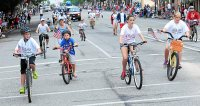 Area residents and Mercury employees riding Bike Pottstown bicycles participate in the 2014 Pottstown 4th of July Parade. John Strickler — The Mercury