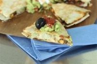 This July 13, 2015 photo shows chickpea, zucchini and chicken quesadillas in Concord, N.H. This dish is from a recipe by Allison Ladman. (AP Photo/Matthew Mead)
