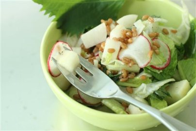 This June 22, 2015 photo shows perilla leaf and pear salad with rice vinegar dressing in Concord, N.H. This dish is from a recipe by Edward Lee. (AP Photo/Matthew Mead)