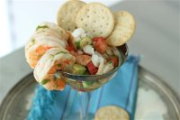 This July 13, 2015 photo shows grilled shrimp margarita with avocado and summer tomatoes in Concord, N.H. This dish is from a recipe by Elizabeth Karmel. (AP Photo/Matthew Mead)