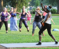 Lizette Clark leads several people in a Zumba dance class at the Memorial Park Wednesday evening. The Pottstown YMCA and The Mercury's Fit for Life initiative co-hosted the free event.