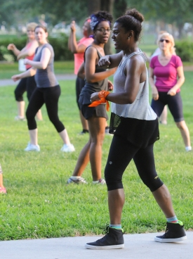 Pottstown YMCA instructor Lizette Clark demonstrates dance moves during a free Zumba class held outside at Memorial Park Wednesday evening.