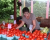 Peggy donates cases of tomatoes to the Pottstown Cluster. Photo by Merrill Weber