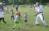 John Strickler - The Mercury Kurt Miller of Master Kim's Black Belt Academy works on martial arts fitness with children at the well field day.