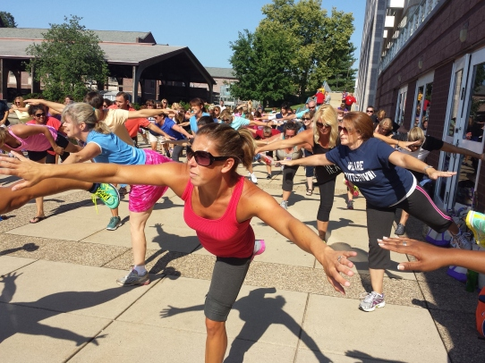 """Educators stretch out their arms and balance on one leg during a morning workout at The Hill School Tuesday for the """"Healthy Bodies, Healthy Minds Institute."""""""